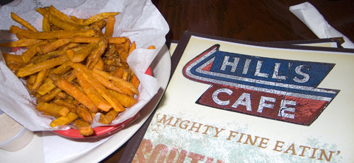 Hill's Cafe menu next to a basket of sweet potato fries.