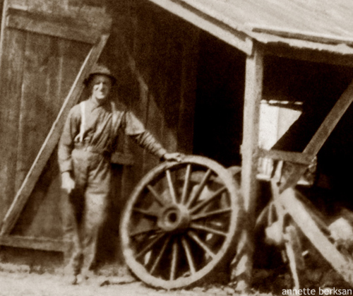 Gus Courrege in front of his blacksmith shop.