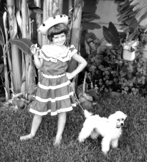 Me with my poodle Beau Jacques in 1960