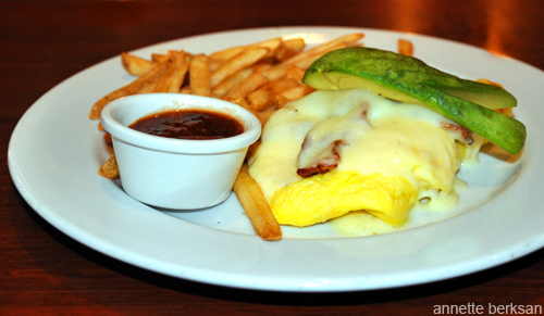 Omelette with fries and avocado.