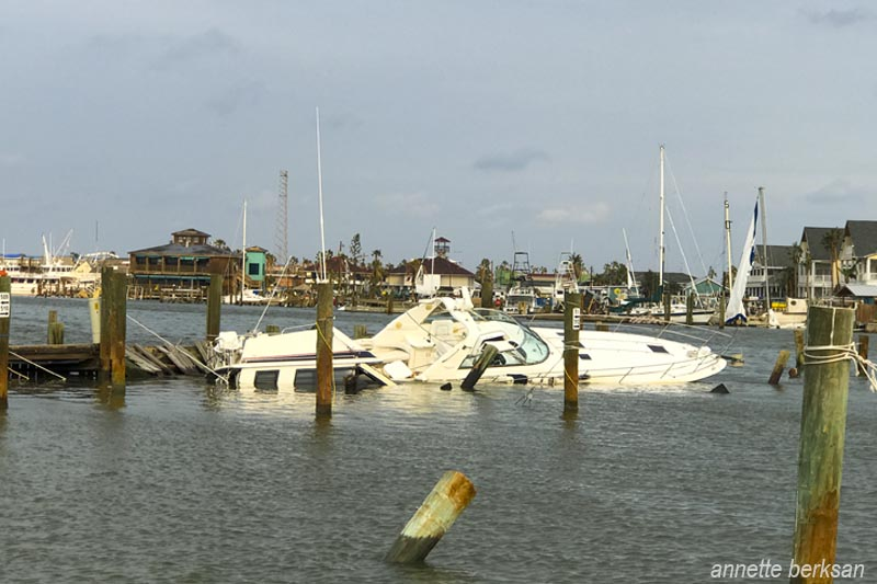 2 partially submerged boats